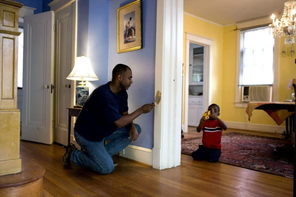 Man painting a house on long island to sell home faster