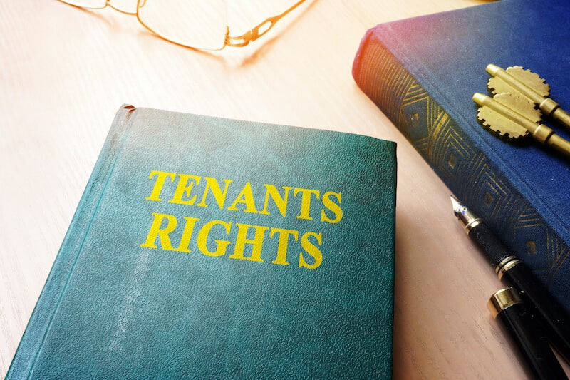 book titled tenants rights with glasses in the backgroud