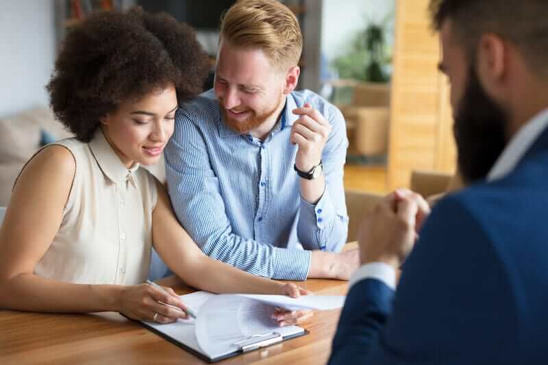 happy couple considering working with cash homebuyer