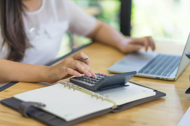 Woman Computing Health and Medical Costs